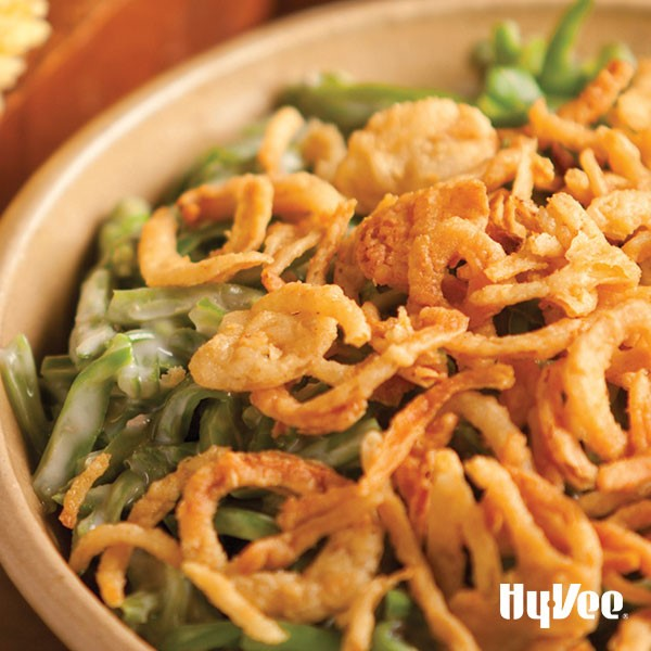 Green beans in creamy white sauce with crispy onions on top