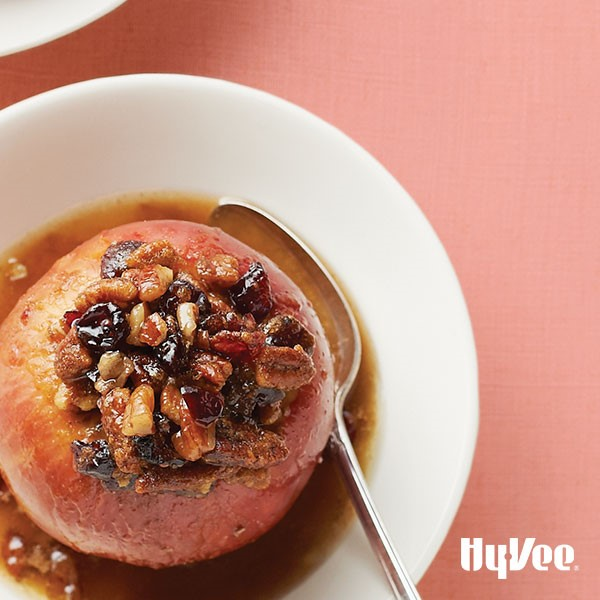 A baked apple filled with cranberries, pecans, brown sugar and cinnamon