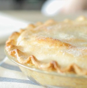 Baked double crusted pie with fluted edge