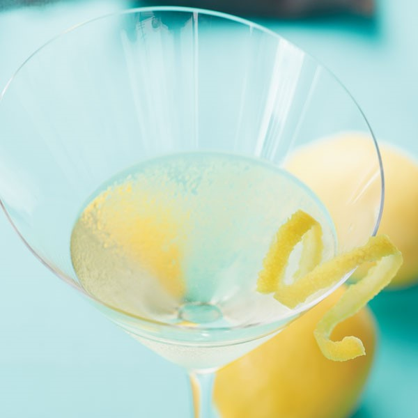 Martini glass filled with Lemon Chiffon Martini and a lemon peel on the rim