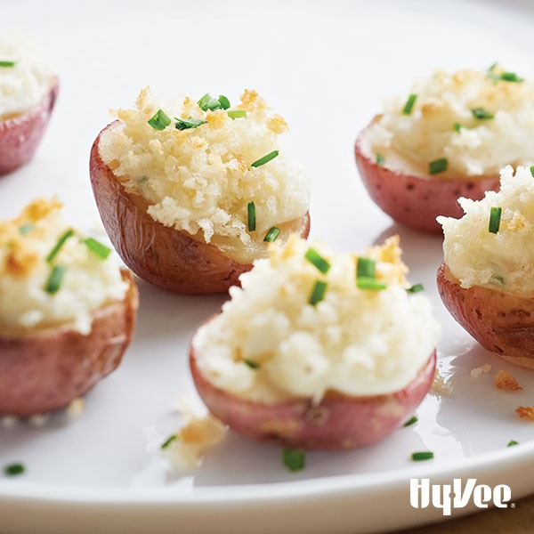 Plate of potatoes stuffed with blue cheese and topped with breadcrumbs and green onions