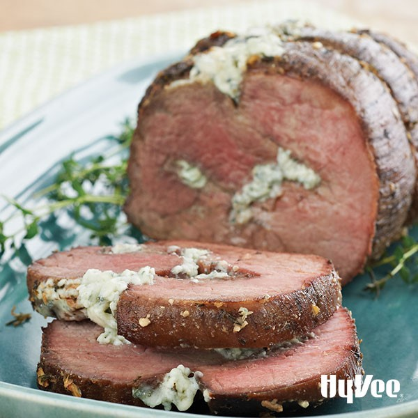 Blue platter of eye-of-round roast stuffed with blue cheese