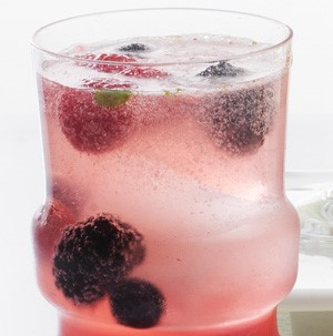 Glass of berry Christmas dazzler with fresh blackberries and raspberries
