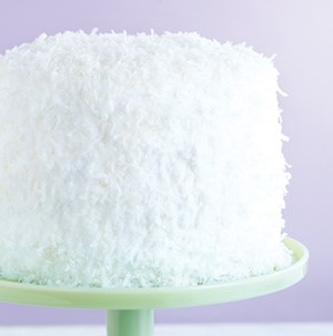 Cake Stand displaying a tall Coconut-covered cake