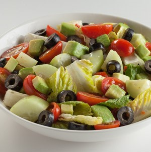 Chopped cucumbers, lettuce, halved cherry tomatoes and sliced black olives