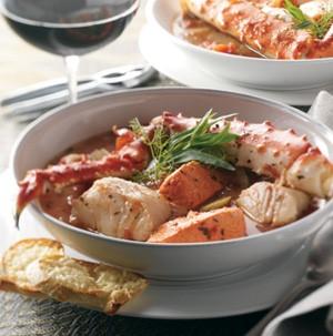 Bowl of broth with Alaska crab and mixed seafood