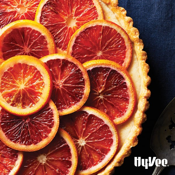 Round mascarpone tart topped with blood orange slices
