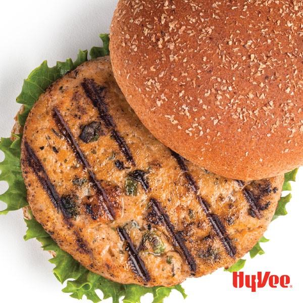 Grilled salmon burger served between a bun