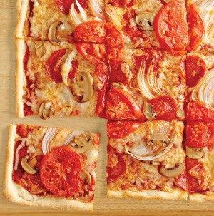 Pizza topped with pepperoni, mushroom, onion and tomato