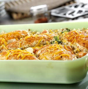 Dish of chicken, seasoned rice and vegetable casserole