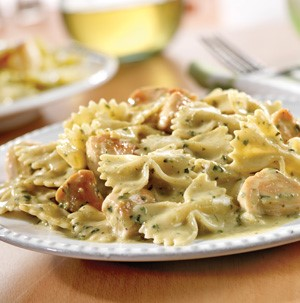 Plate of creamy pesto chicken and bow ties