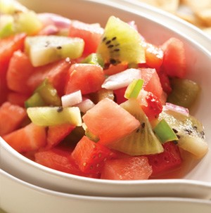 Chopped watermelon, kiwi, and strawberries in a white bowl