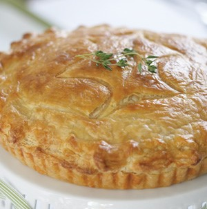 Dish filled with baked breakfast quiche