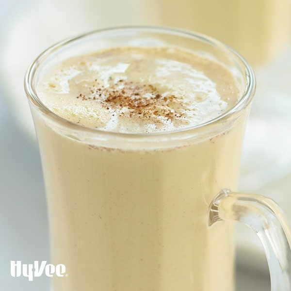 Glass of spiced eggnogg, garnished with grated nutmeg