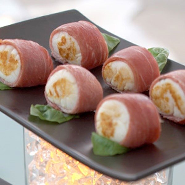 Tray of prosciutto-wrapped scallops