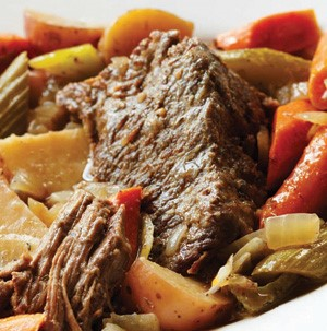 Pot roast mixed with roasted vegetables