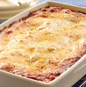 9 by 13-inch casserole pan with red sauce topped with cheese