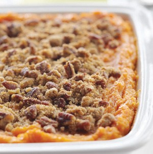 Sweet potato casserole topped with brown sugar, butter and pecans