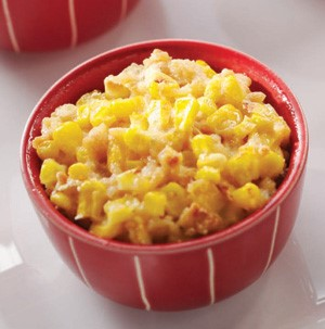 Creamed corn casserole in a red bowl