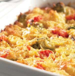 Casserole dish filled with cheesy vegetables and rice