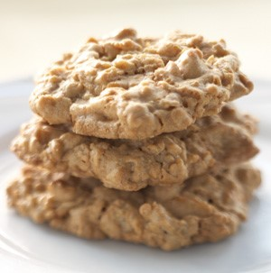 Stacked oatmeal cookies on a white plate