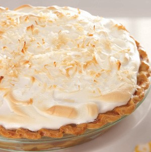 Coconut cream pie topped with toasted coconut flakes