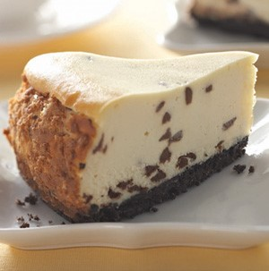 Slice of chocolate chip cheesecake on a white plate