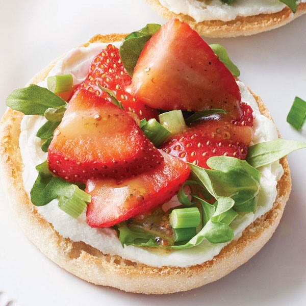 English muffin topped with goat cheese, arugula, green onion and strawberries
