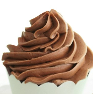 Cupcake topped with chocolate buttercream frosting