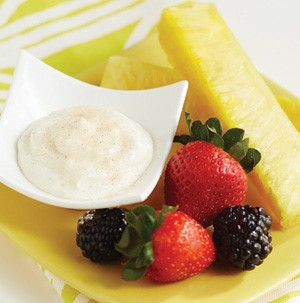 Side of creamy dip served with fresh fruit