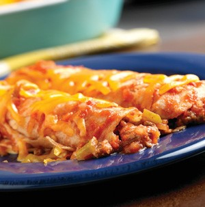 Beef enchiladas covered in cheese on a blue plate