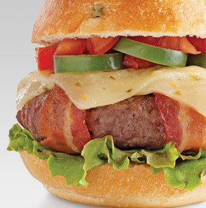 Bacon-wrapped burger topped with pepper jack cheese, jalapenos and tomatoes