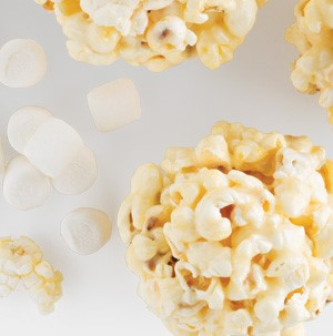 Popcorn balls with mini marshmallows on the side