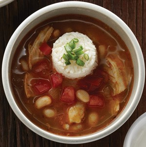 Soup with white beans, diced tomatoes, white rice, and chopped green onions