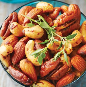 Cashews, almonds and pecans mixed togther and garnished with a sprig of thyme