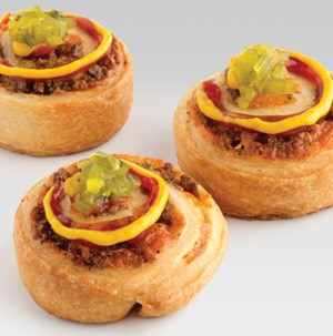 Cheeseburger roll-ups garnished wtih ketchup, mustard and relish