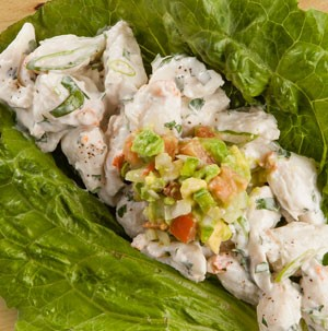 Crab salad topped with fresh guacamole and served on romaine lettuce