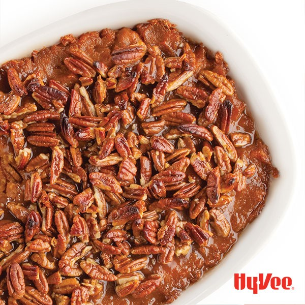 Casserole Dish of Sweet Potato Puree, topped with Toasted Pecans
