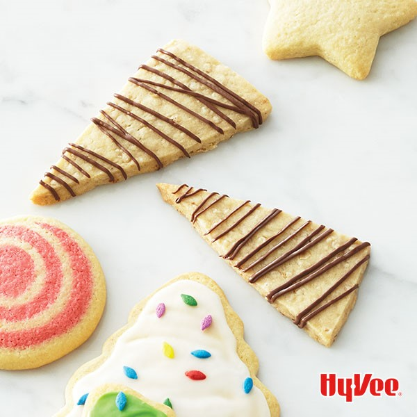 Shortbread cookies drizzled in chocolate or iced with sprinkles