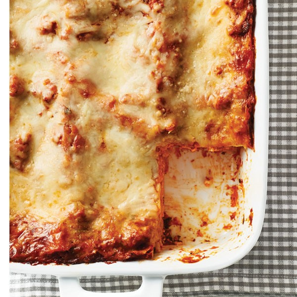 Dish of lasagna with a slice cut out