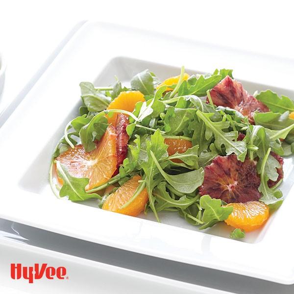 Dish of citrus salad with clementine-avocado vinaigrette