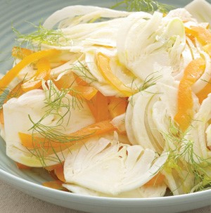 Sliced fennel, yellow onions and garnished with fennel fronds