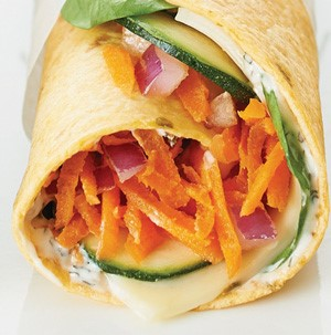 Shredded carrots, sliced, cheese, red onion, and cucumber wrapped in a tortilla