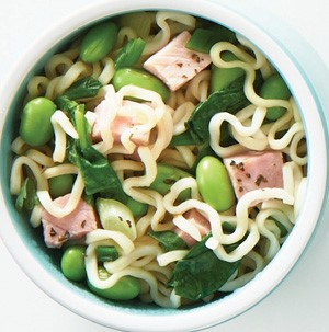 Noodle bowl filled with spinach, shelled edamame, and diced ham