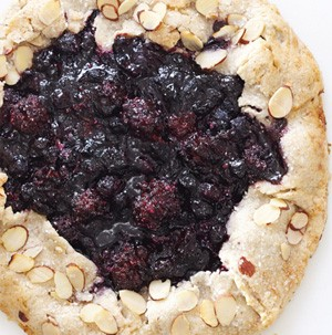 Open-faced berry crostada with pastry crust and almonds