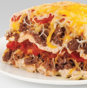 Layered lasagna filled with ground meat, tomatoes, and cheese