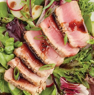 Salad topped with ahi tuna steak