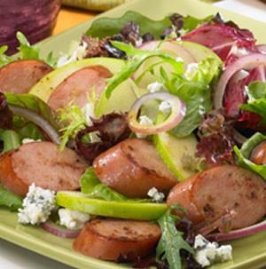 Plate of crisp apple and sausage salad