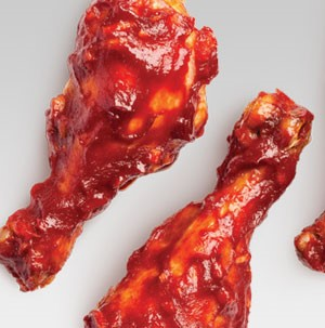 Two chicken legs baked in a barbecue sauce