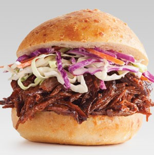 BBQ beef and coleslaw sandwiched between a bun